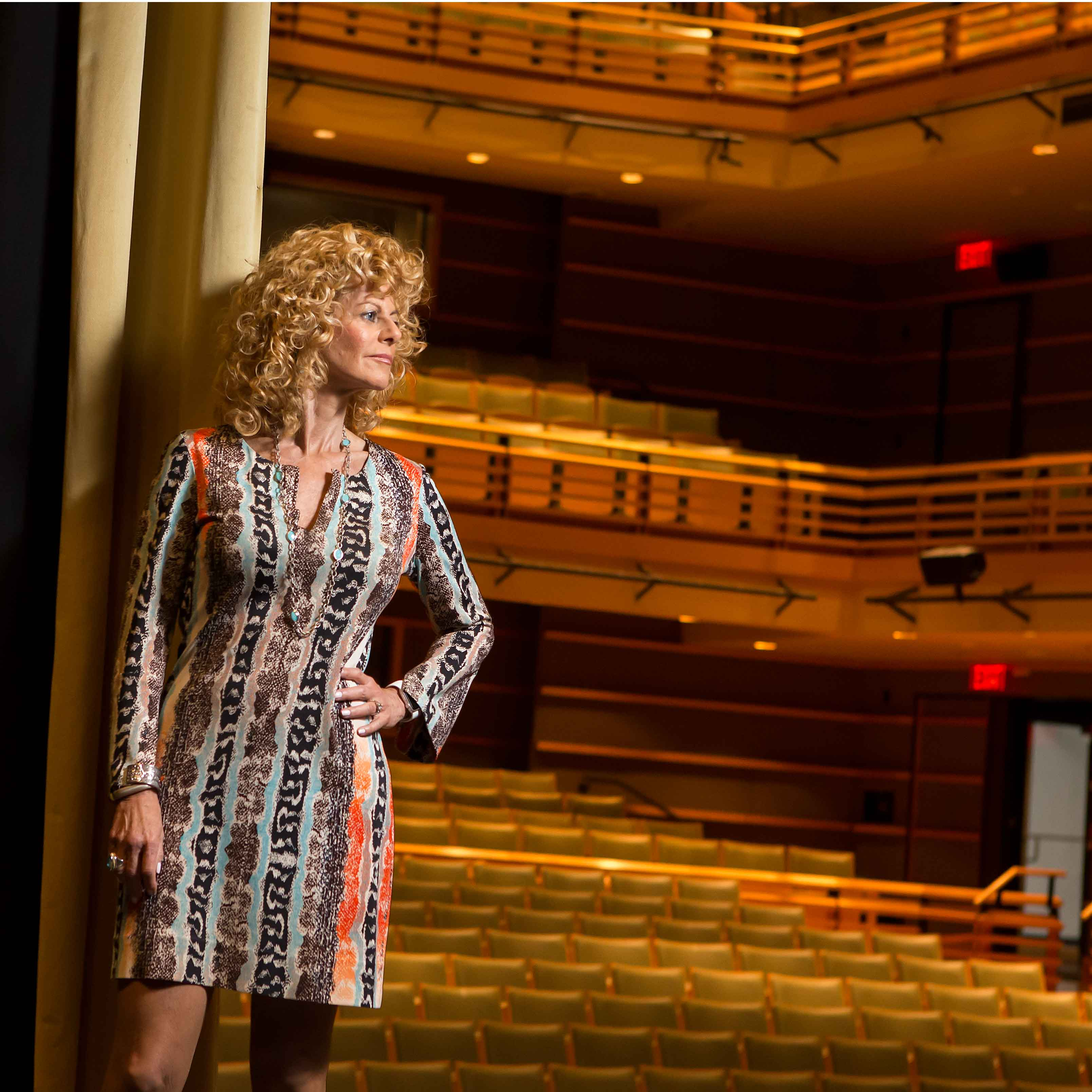 Sharon Pinkenson standing in an empty theater.